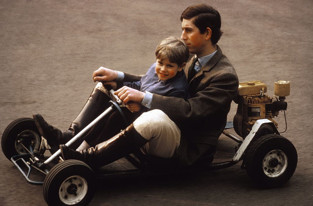 Image Credit: Getty Images / Prince Charles and his youngest brother Prince Edward go for a spin in their go-kart on the grounds of Windsor Castle in May 1969 near Windsor, Berkshire, England.