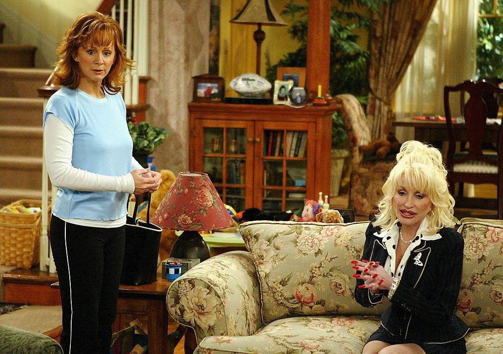 Image Credit: Getty Images / Acclaimed singer and actress, Reba McEntire on set alongside Dolly Parton.