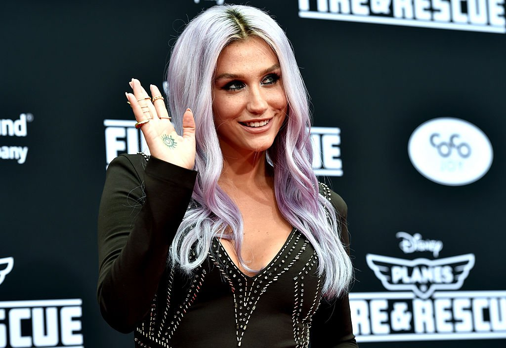 Image Credit: Getty Images / Singer Kesha poses for photographers at an event.