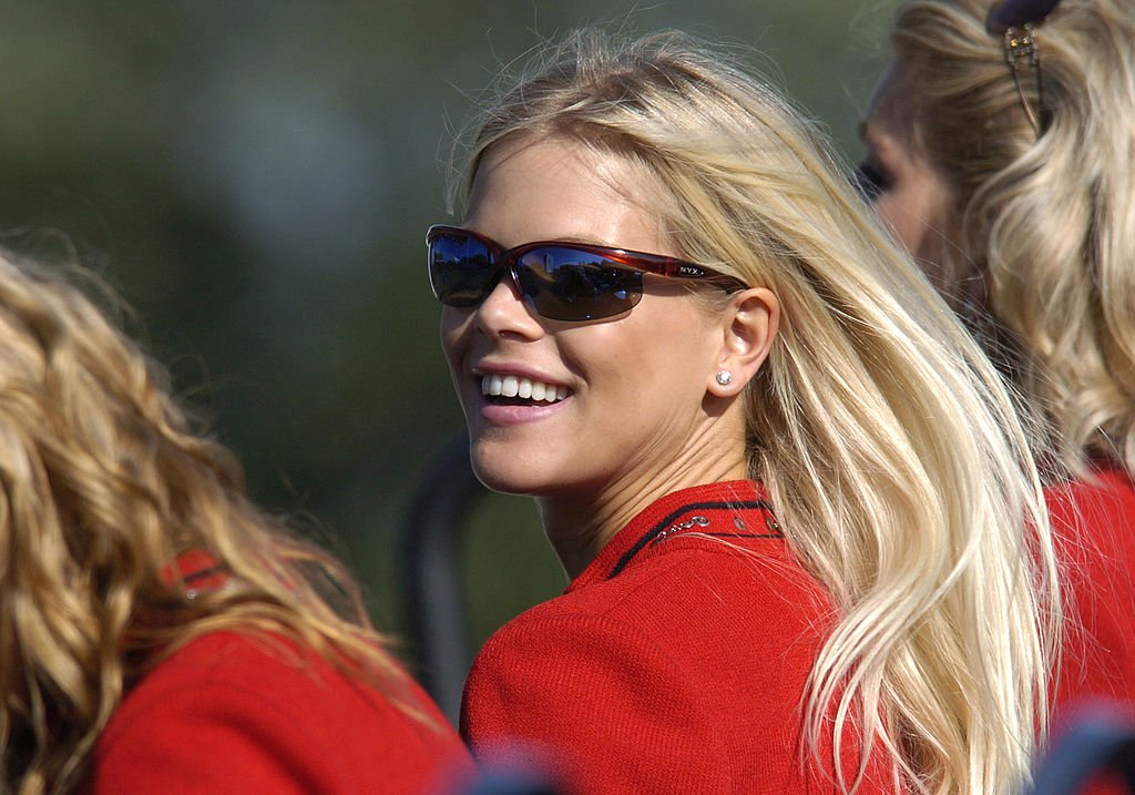 Image Credits: Getty Images / Leon Halip / WireImage | Elin Nordegren watches the opening ceremonies for the 35th Ryder Cup at Oakland Hills C.C. Thursday afternoon.