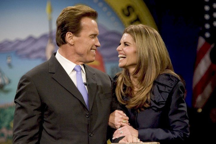 Image Credit: Getty Images/David Paul Morris | Former California Governor Arnold Schwarzenegger smiles at his ex-wife Maria Shriver