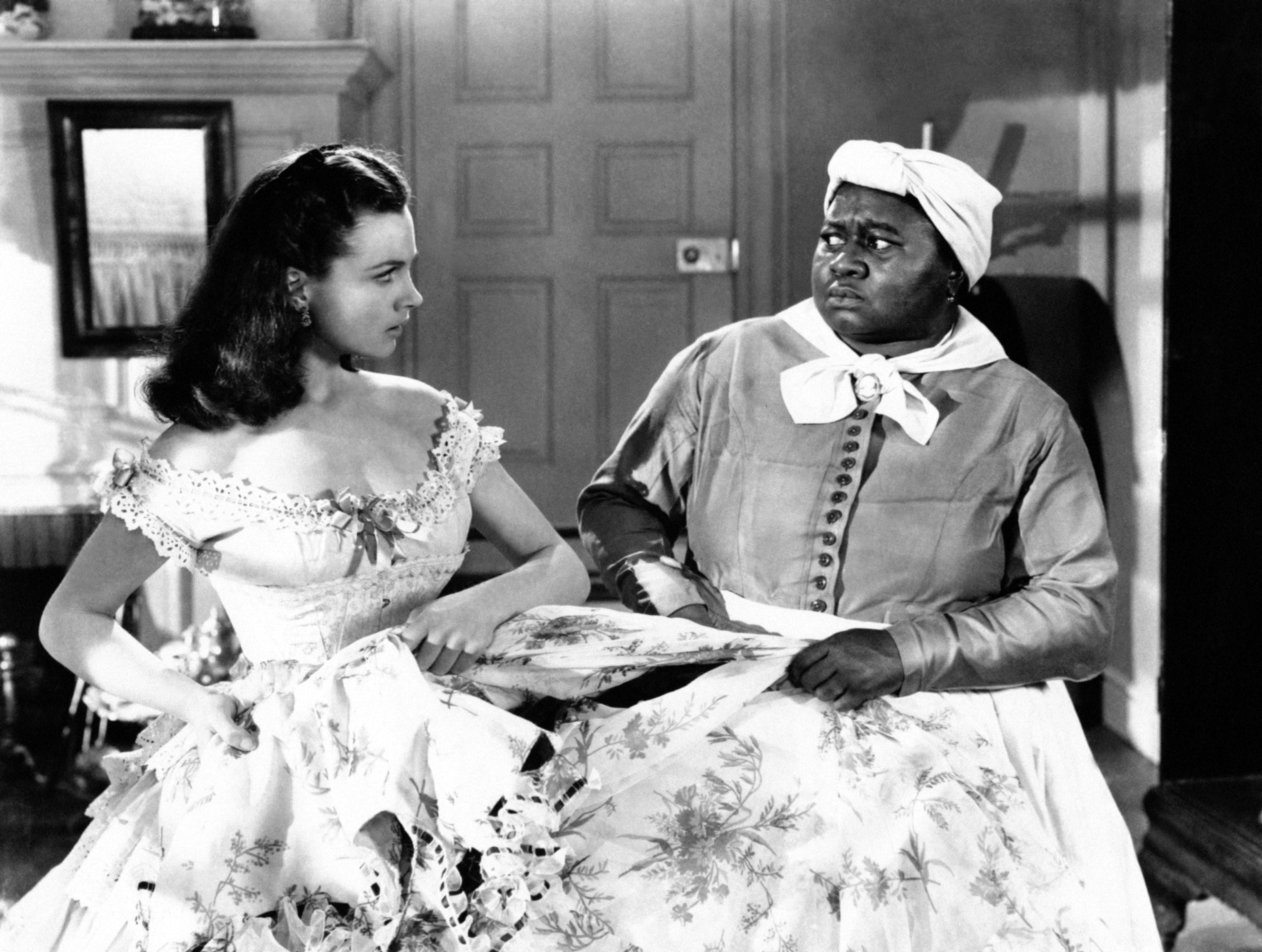 "Image Credits: Getty Images | Vivien Leigh with actress Hattie McDaniel in a scene from ""Gone With The Wind"""
