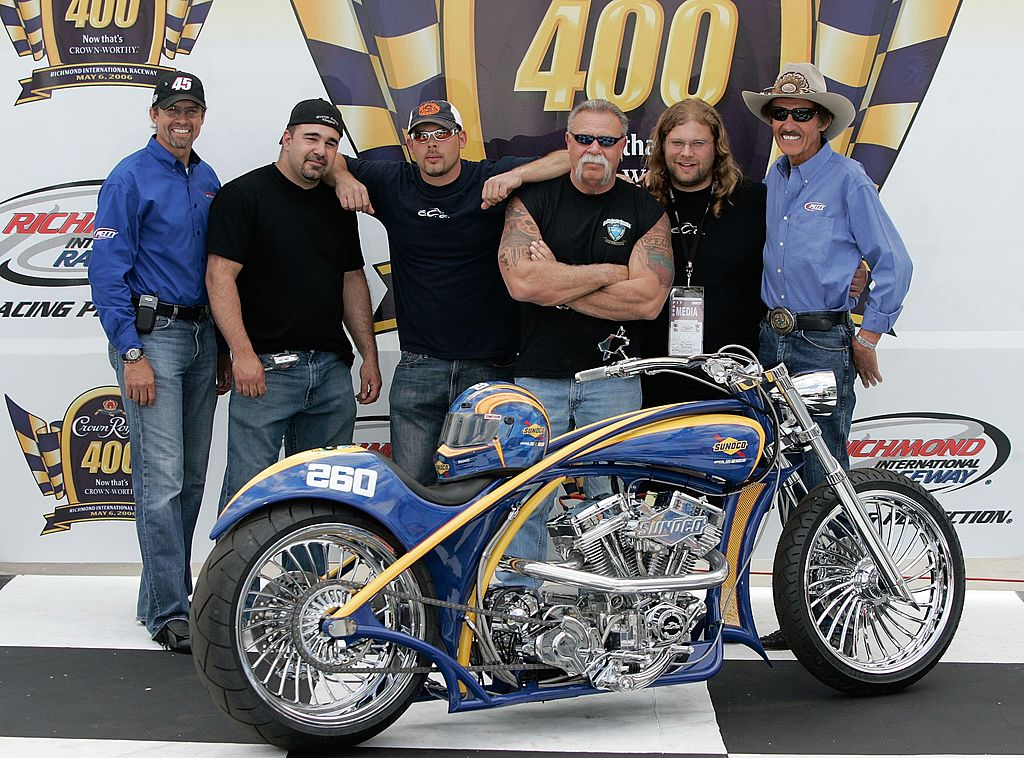 Image Credits: Getty Images / Dilip Vishwanat | (L-R) Kyle Petty of Petty Enterprises, Vince DiMartino, Paul Teutul Jr. Paul Teutul Sr. Mikey Teutul (of Orange County Choppers) and Richard Petty of Petty Enterprises, unveil the OCC Custom Sunoco Motorcycle prior to the NASCAR Nextel Cup Series Crown Royal 400 May 6, 2006 in Richmond, Virgina.