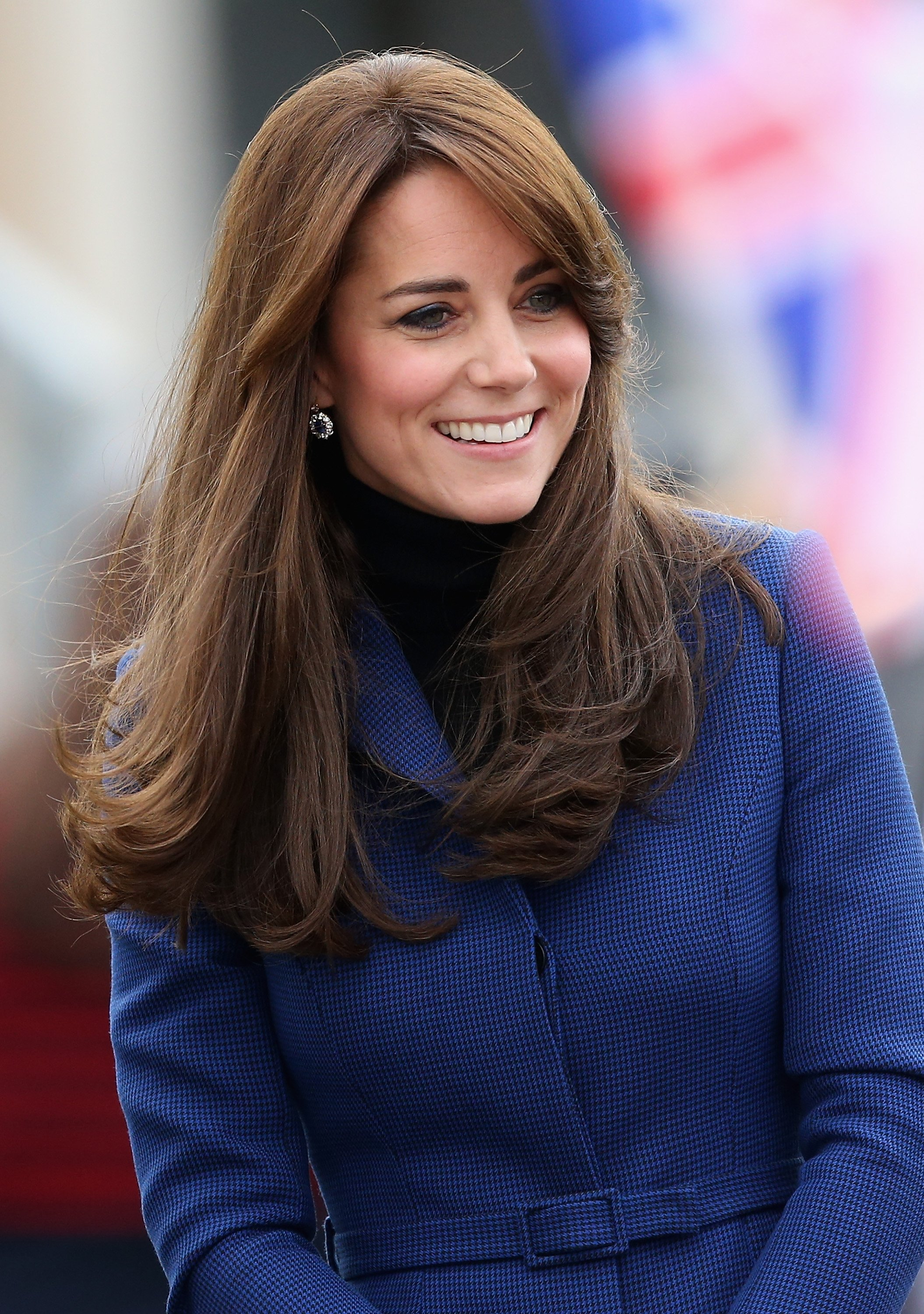 Image Source: Getty Images/Kate wearing a blue coat