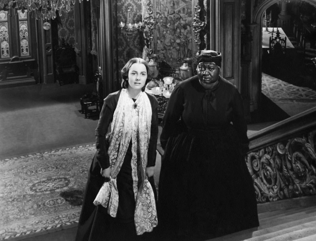 "Image Credits: Getty Images / Donaldson Collection | Olivia de Havilland and Hattie McDaniel in a scene from the movie ""Gone with the Wind"""