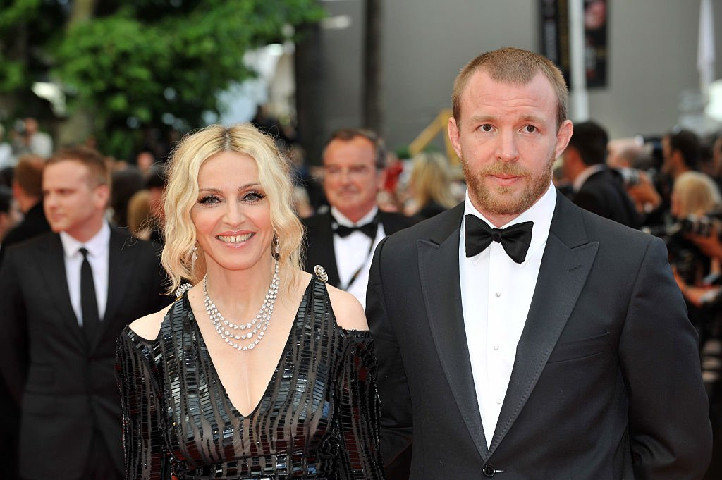 """Image Credit: Getty Images / Singer Madonna and husband Guy Ritchie attend the premiere of """"Che"""" during the 61st Cannes Film Festival."""