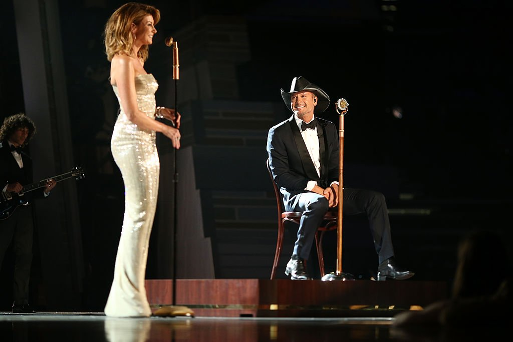Image Credits: Getty Images / Christopher Polk / ACMA2014 | Recording artists Faith Hill (L) and Tim McGraw perform onstage during the 49th Annual Academy of Country Music Awards at the MGM Grand Garden Arena on April 6, 2014 in Las Vegas, Nevada.