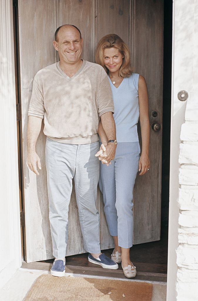 Image Credits: Getty Images / Martin Mills | Actress Elizabeth Montgomery and her husband producer and director Bill Asher pose for a portrait at home in 1966 in Beverly Hills, California.