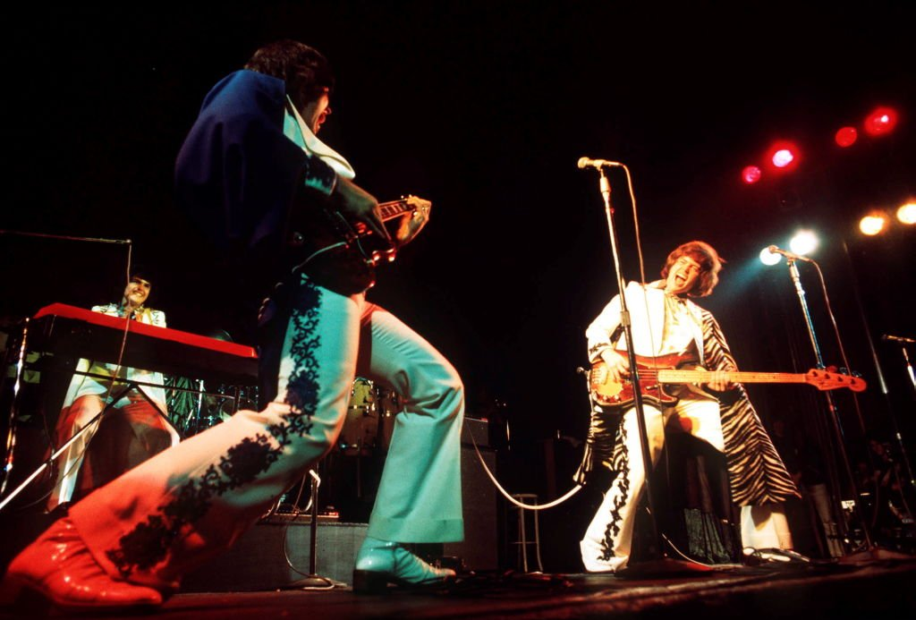Image Credit: Getty Images / The Osmonds perform on stage, London, 1975, L-R Donny Osmond, Alan Osmond, Merrill Osmond.