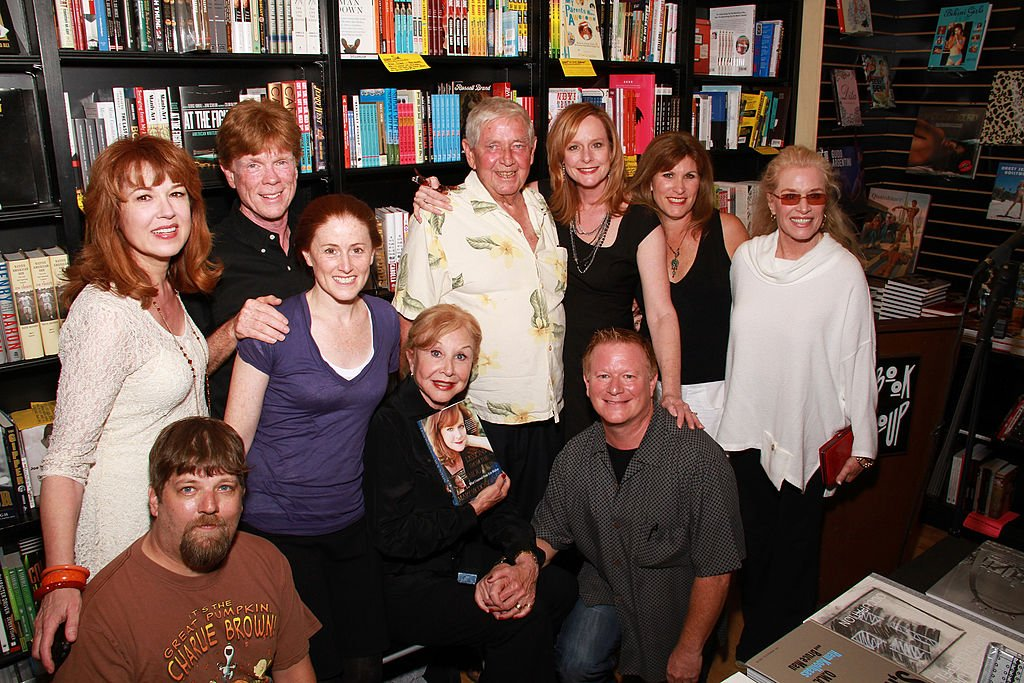 Image Credits: Getty Images / Brian Putnam | (L-R) Cast members from 'The Waltons' Lee Purcell, David W. Harper, Jon Walmsley, Kami Cotler, Michael Learned, Ralph Waite, Mary McDonough, Eric Scott, Judy Norton and Cissy Wellman attend the signing of Mary McDonough's book 'Lessons From the Mountain: What I Learned From Erin Walton' at Book Soup on April 16, 2011 in West Hollywood, California.