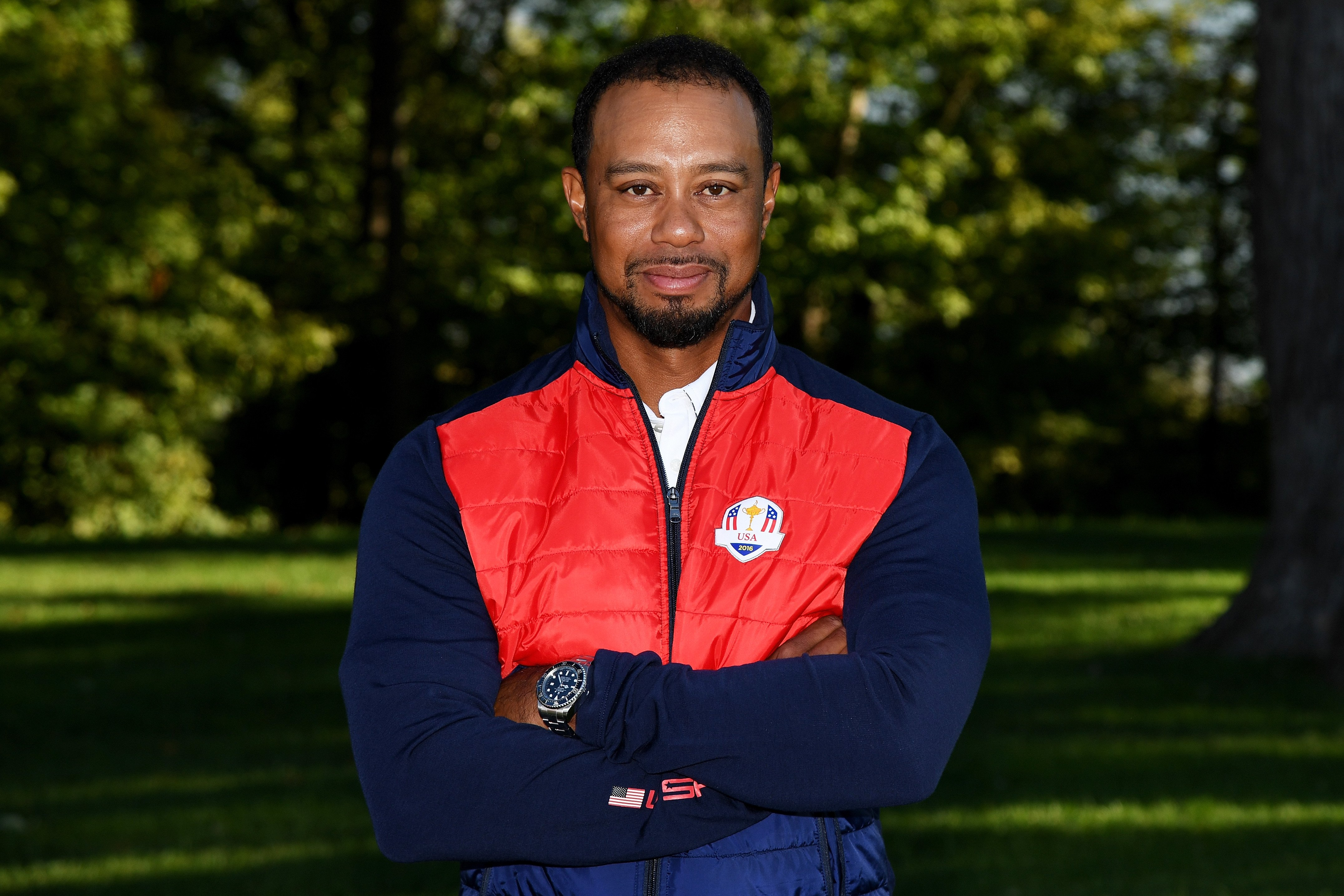 Image Credits: Getty Images / Ross Kinnaird | Vice-captain Tiger Woods of the United States poses during team photocalls prior to the 2016 Ryder Cup at Hazeltine National Golf Club on September 27, 2016 in Chaska, Minnesota.