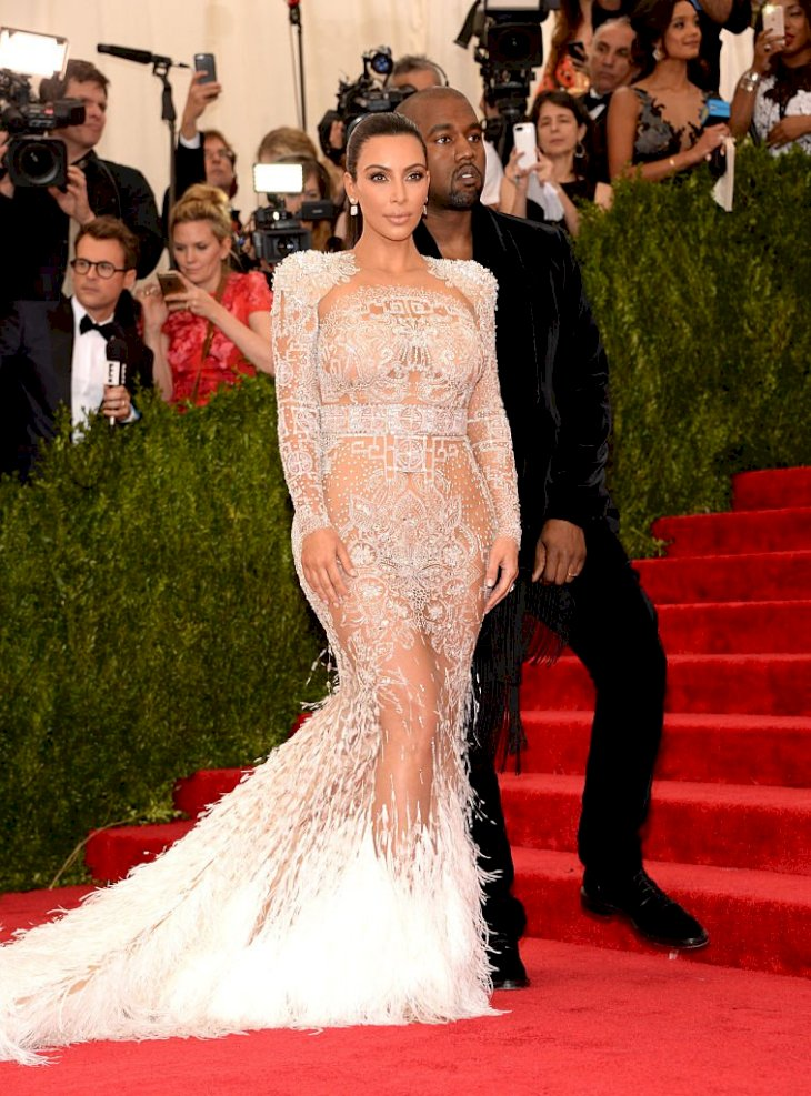 Image Credit: Getty Images / Kanye West and Kim Kardashian on the red carpet.