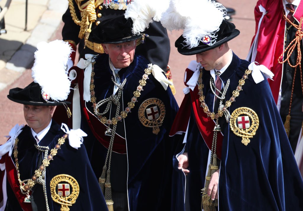 Image Credit: Getty Images / Prince Edward, Earl of Wessex, Prince Charles, Prince of Wales and Prince William, Duke of Cambridge march during the Order Of The Garter Service at Windsor Castle on June 18, 2018 in Windsor, England.