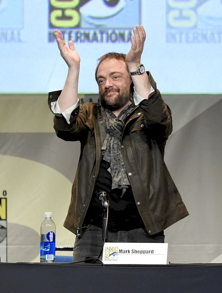 "Image Credits: Getty Images / Kevin Winter | Actor Mark Sheppard speaks onstage at the ""Supernatural"" panel during Comic-Con International 2015 at the San Diego Convention Center on July 12, 2015 in San Diego, California."