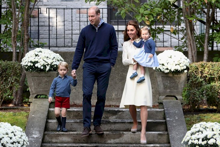 Image Credit: Getty Images / Catherine, Duchess of Cambridge, Princess Charlotte of Cambridge, Prince George of Cambridge and Prince William, Duke of Cambridge arrive for a children's party.