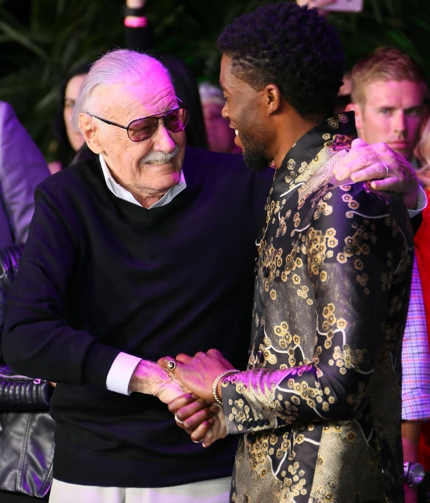 Image Credits: Getty Images / JB Lacroix / WireImage | Stan Lee and Chadwick Boseman attend the premiere of Disney and Marvel's 'Black Panther' on January 28, 2018 in Los Angeles, California.