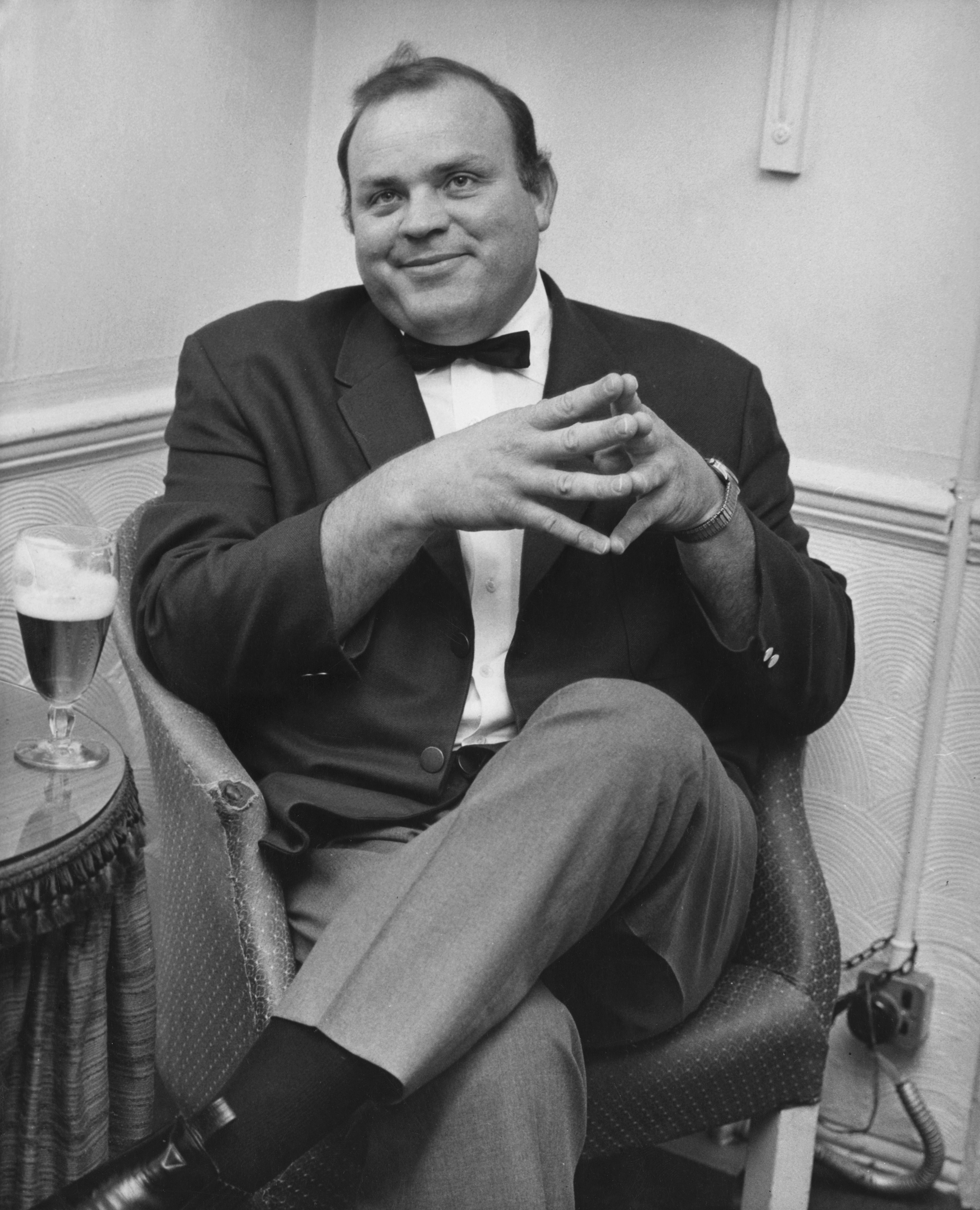 Image Source: Getty Images/ Dan Blocker sitting on a chair