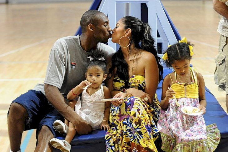 Image Credits: Getty Images / Jesse D. Garrabrant / NBAE | Kobe Bryant #10 of the U.S. Men's Senior National Team celebrates his birthday with his family, Nyla, Vanessa and Natalia during practice at the 2008 Beijing Summer Olympics on August 23, 2008 at the University of Beijing gymnasium in Beijing, China.