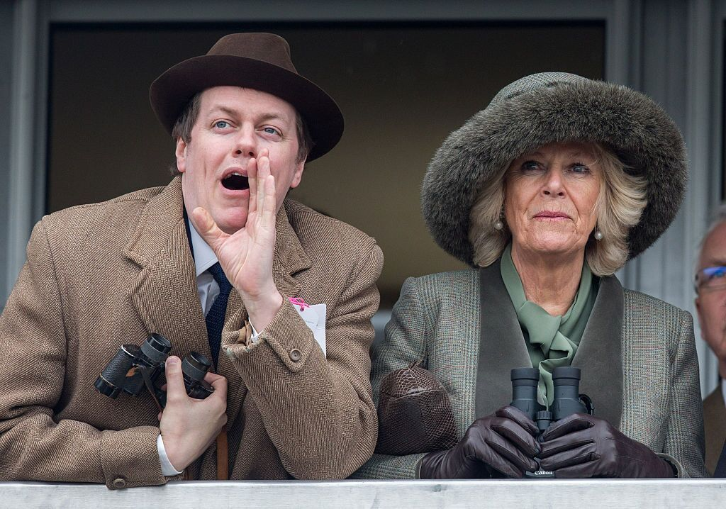 Image Credit: Getty Images/Matt Cardy - WPA Pool | Camilla, Duchess of Cornwall watches a race from the temporary Royal Box with her son Tom Parker Bowles