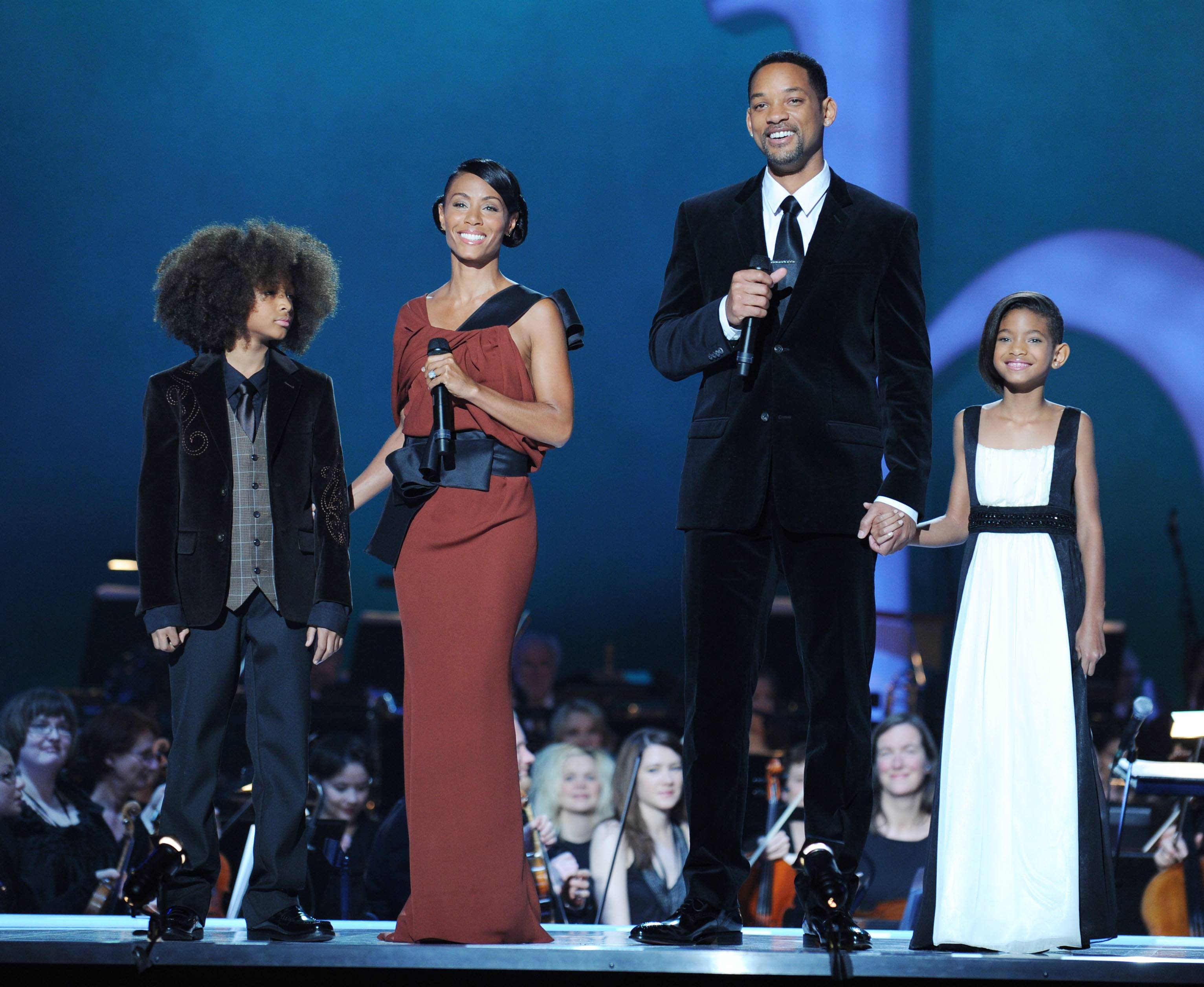 Image Credits: Getty Images / Sandy Young | Hosts Jade Pinkett Smith (2nd L) and Will Smith with children Jaden Smith (L) and Willow Smith (R) onstage during the Nobel Peace Prize Concert at Oslo Spektrum on December 11, 2009 in Oslo, Norway. Tonight's Nobel Peace Prize Concert is hosted by Will Smith and Jada Pinkett Smith and honours this year's Nobel Peace Prize winner US President Barack Obama.