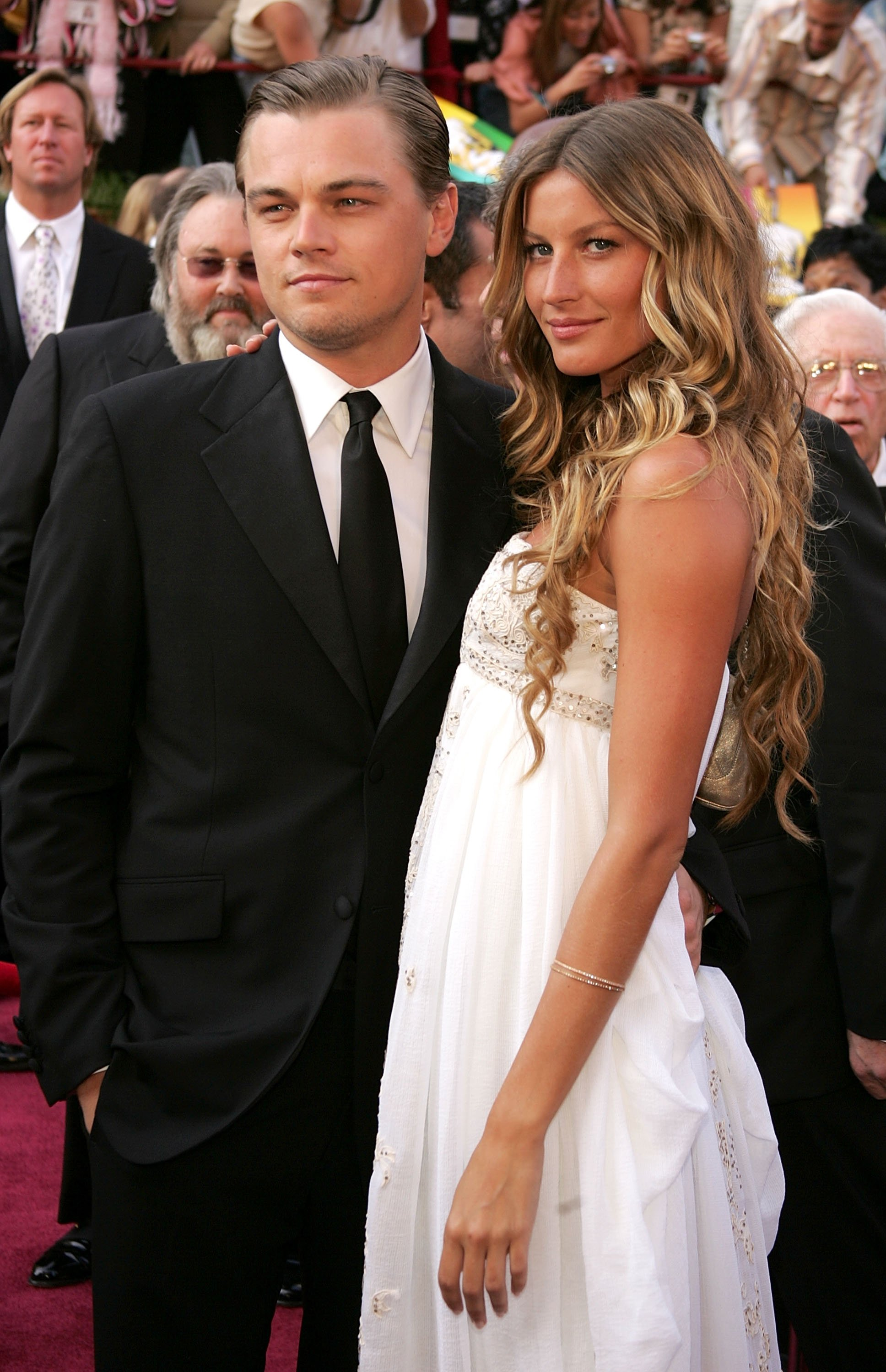 "Image Source: Getty Images/Frank Micelotta| Actor Leonardo DiCaprio, nominated for Best Actor for his role in ""The Aviator,"" arrives with girlfriend Brazilian model Gisele Bundchen at the 77th Annual Academy Awards at the Kodak Theater on February 27, 2005 in Hollywood, California"