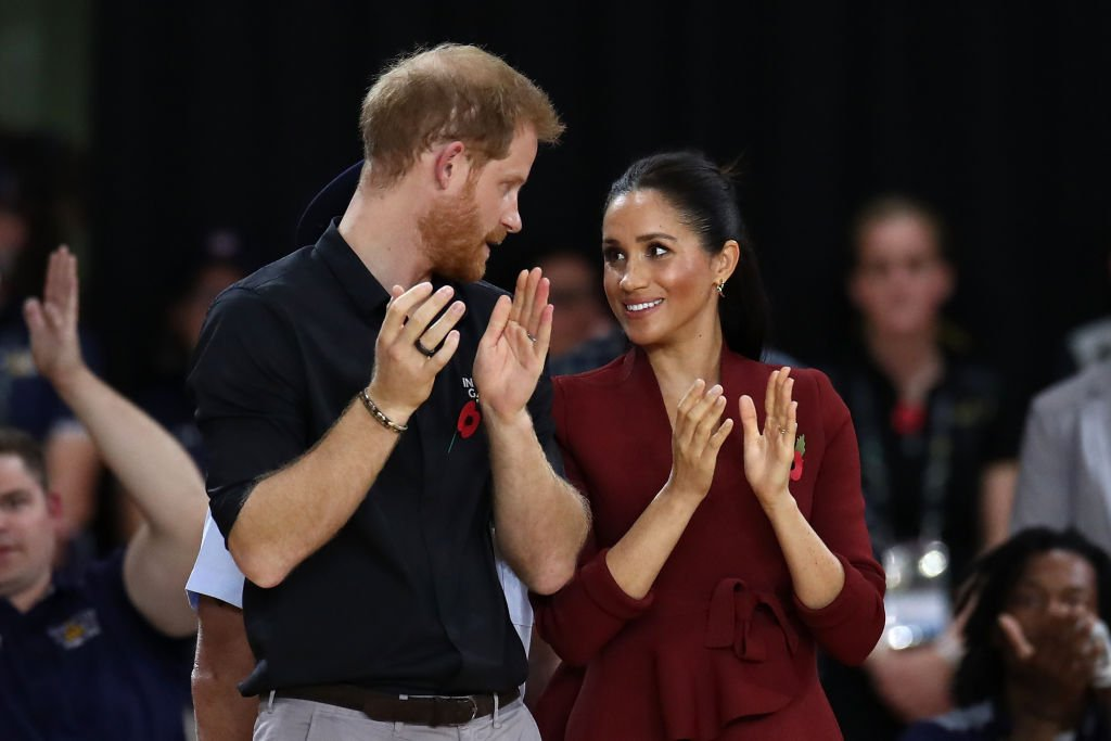 Image Credit: Getty Images / Prince Harry, Duke of Sussex and Meghan, the Duchess of Sussex participate in the medal ceremony following the gold medal match of the Wheelchair Basketball between the Netherlands and the United States.