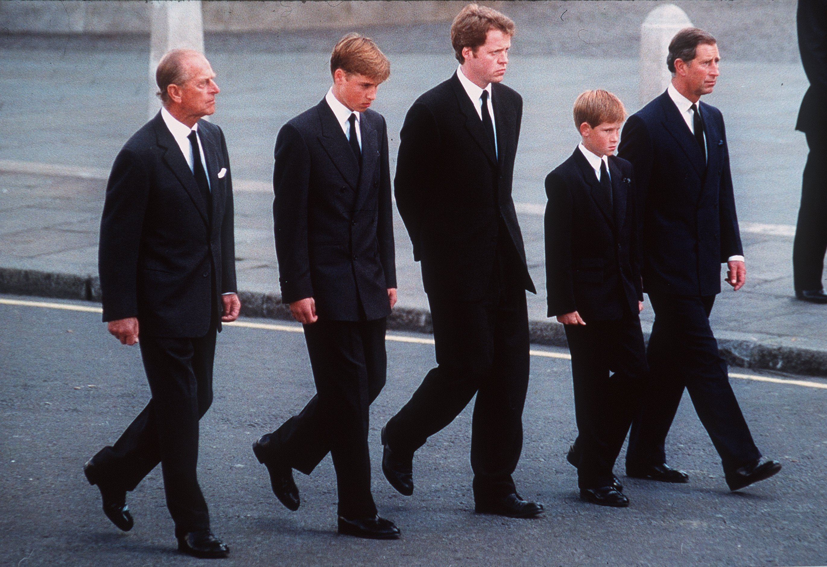 Image Credits: Getty Images / Anwar Hussein   Prince Philip, the Duke of Edinburgh, Prince William, Earl Spencer, Prince Harry and Prince Charles, the Prince of Wales follow the coffin of Diana, Princess of Wales this in September 6, 1997 file photo in London, England.