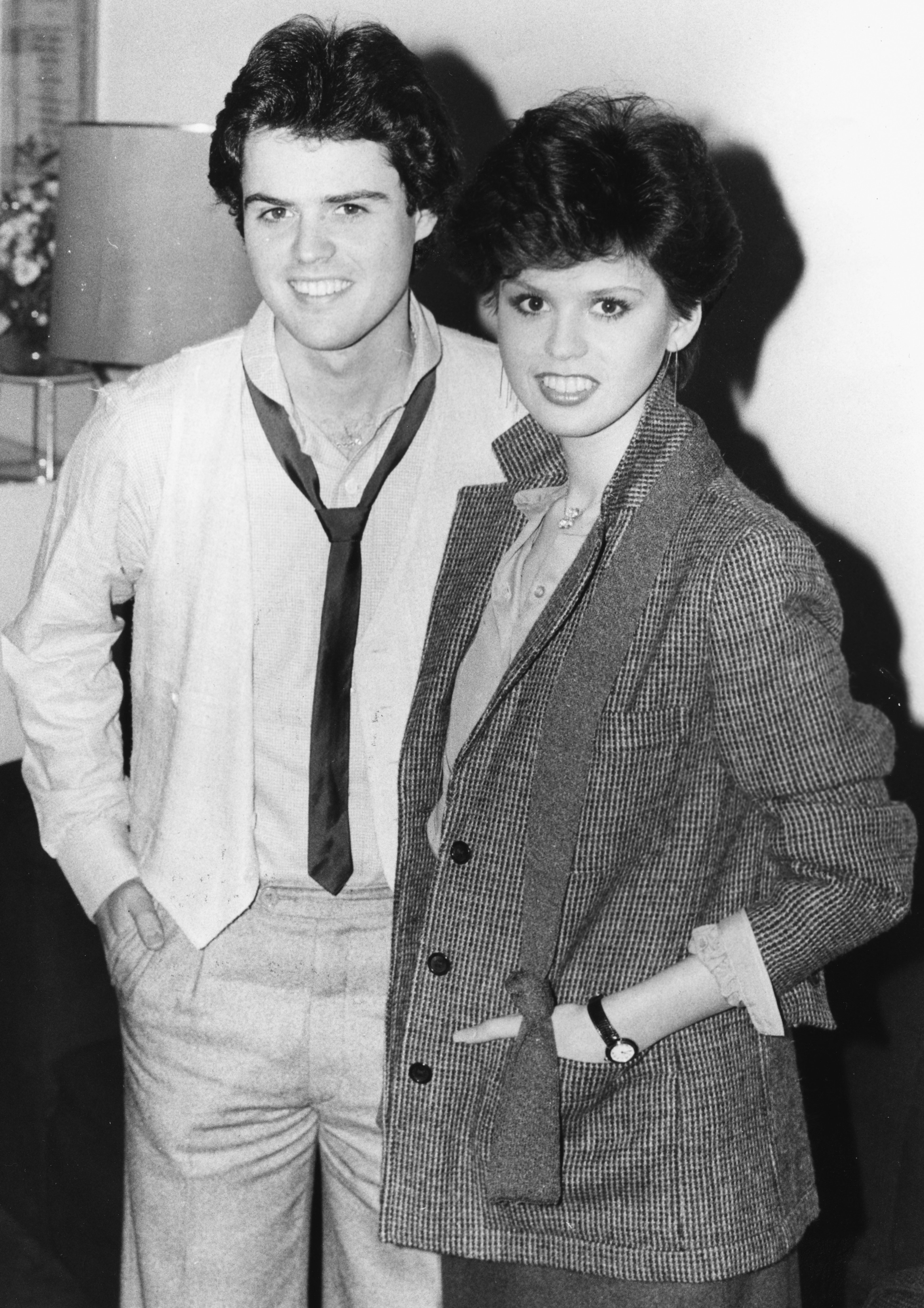 Image Credits: Getty Images / Monti Spry / Central Press | Singers and siblings Donny and Marie Osmond, smiling for the cameras at a press conference, London, January 22nd 1979.