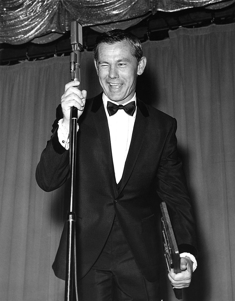Image Credits: Getty Images / Michael Ochs Archives | Johnny Carson host of the Tonight Show, performs at the Sahara Hotel circa 1965 in Las Vegas, Nevada.