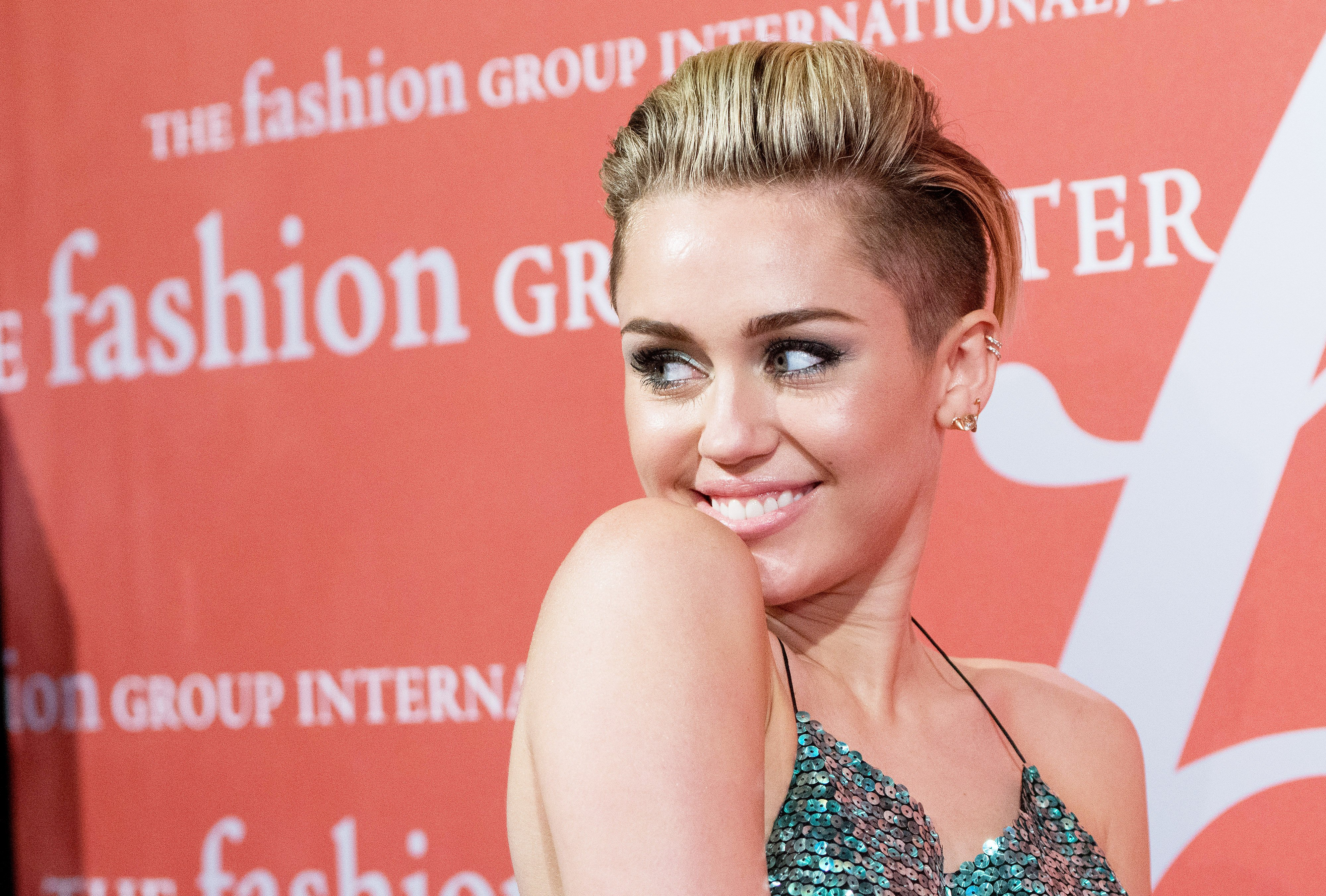 Image Source: Getty Images/Miley at a fashion event