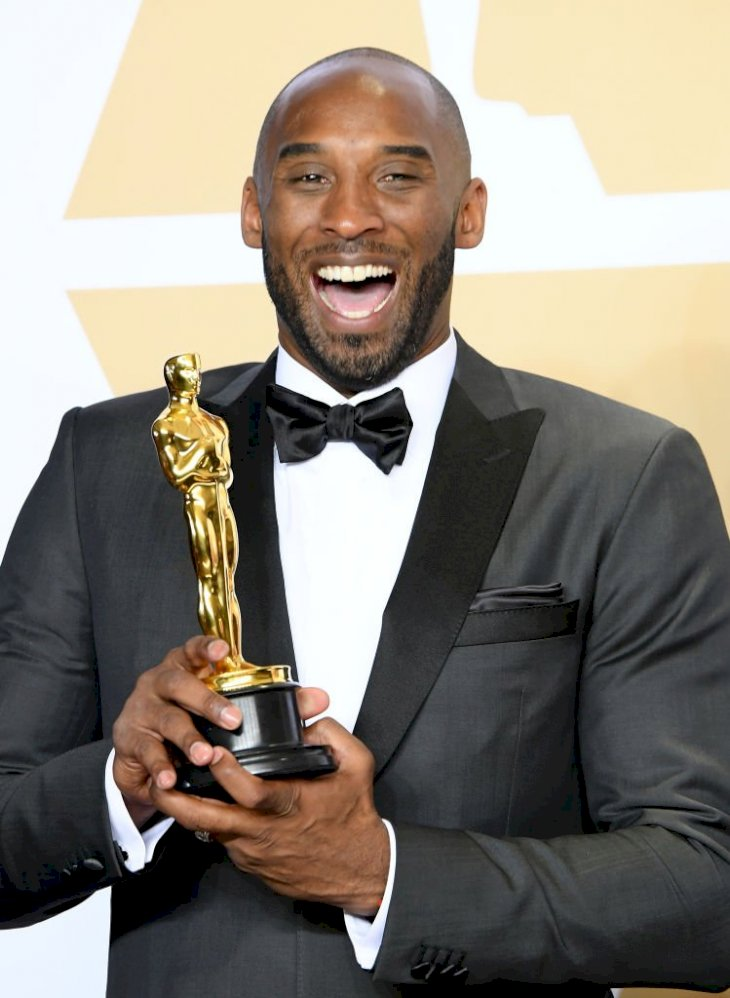 "Image Credits: Getty Images / Steve Granitz / WireImage | Filmmaker Kobe Bryant, winner of the Animated Short award for ""Dear Basketball"" poses in the press room during the 90th Annual Academy Awards at Hollywood & Highland Center on March 4, 2018 in Hollywood, California."