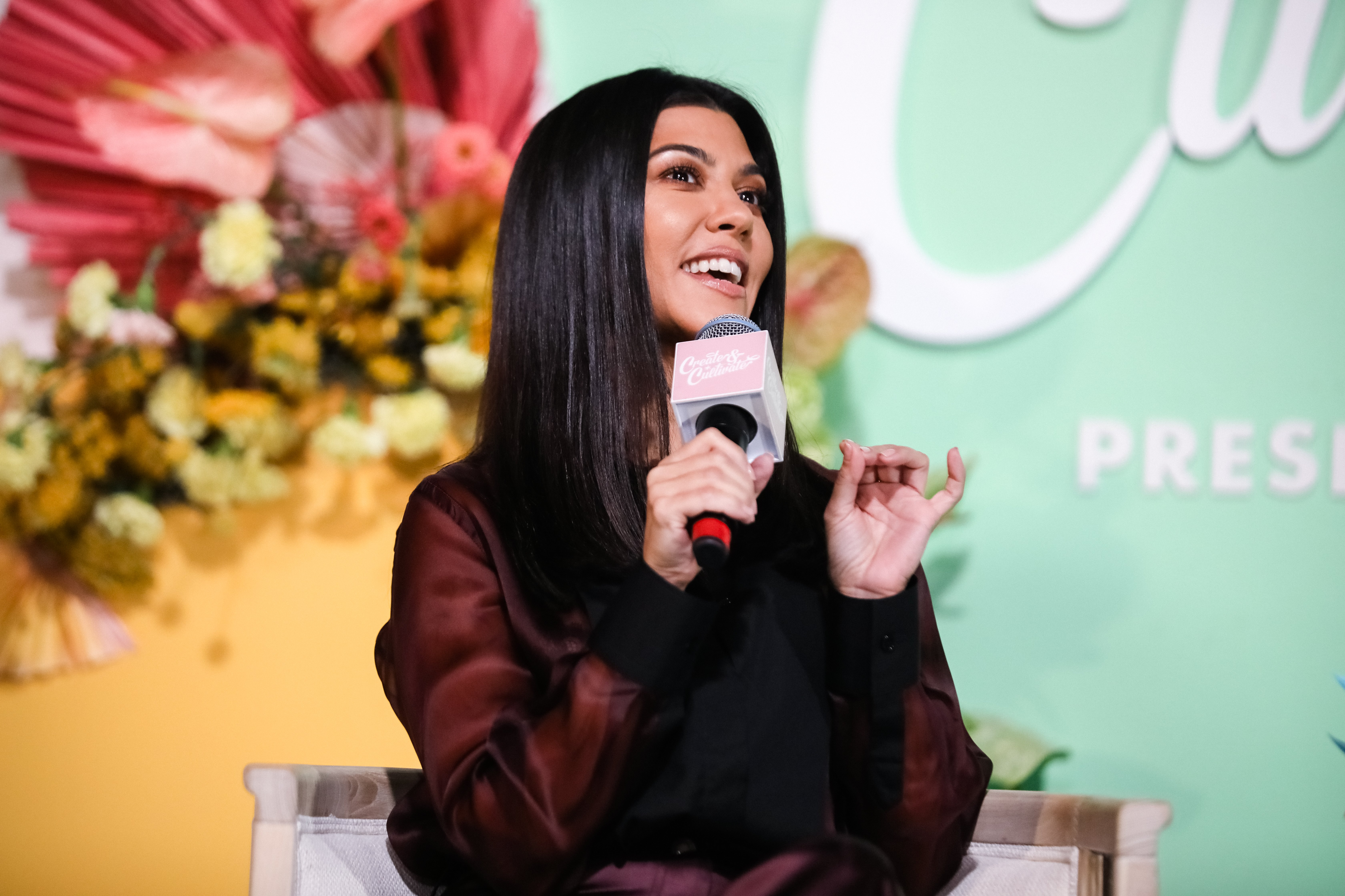Image Credits: Getty Images / Kelly Sullivan | CEO and founder of Poosh, Kourtney Kardashian speaks onstage the Create & Cultivate Conference