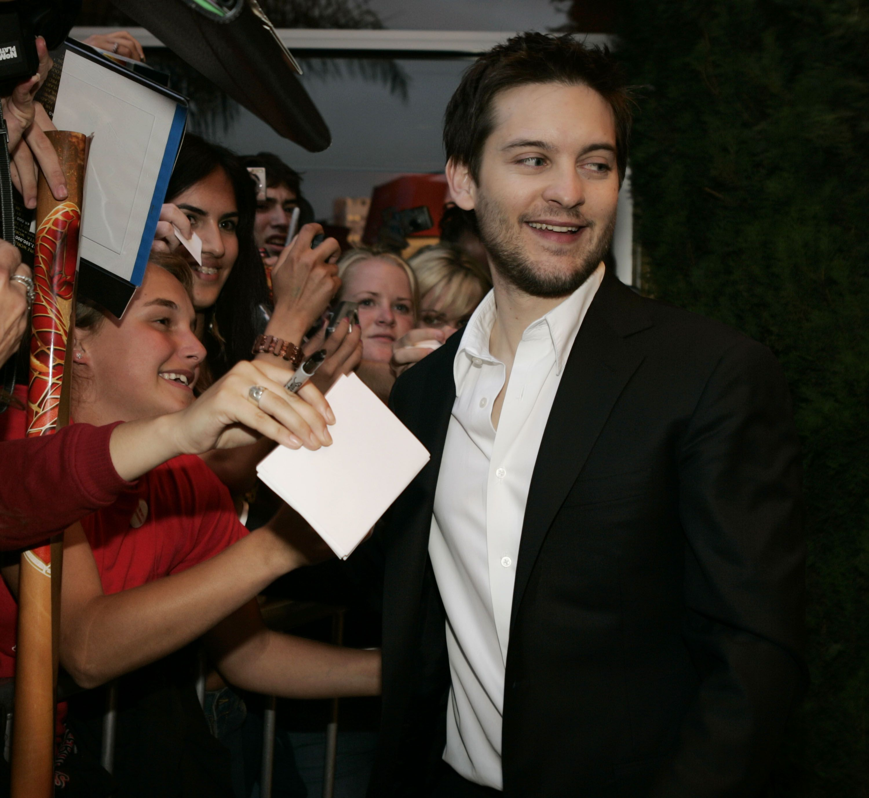 Tobey Maguire Giving Out Autographs / Getty Images