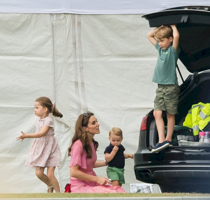 Image Credit: Getty Images / Catherine, Duchess of Cambridge, Prince Louis, Prince George and Princess Charlotte attend The King Power Royal Charity Polo Day at Billingbear Polo Club.