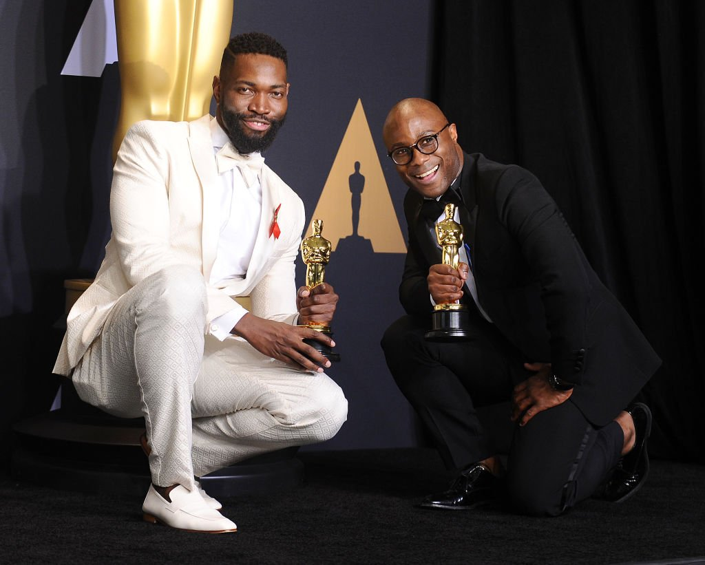 Image Credits: Getty Images / Jason LaVeris/FilmMagic | Screenwriter Tarell Alvin McCraney and writer/director Barry Jenkins, winners of Best Adapted Screenplay for 'Moonlight'