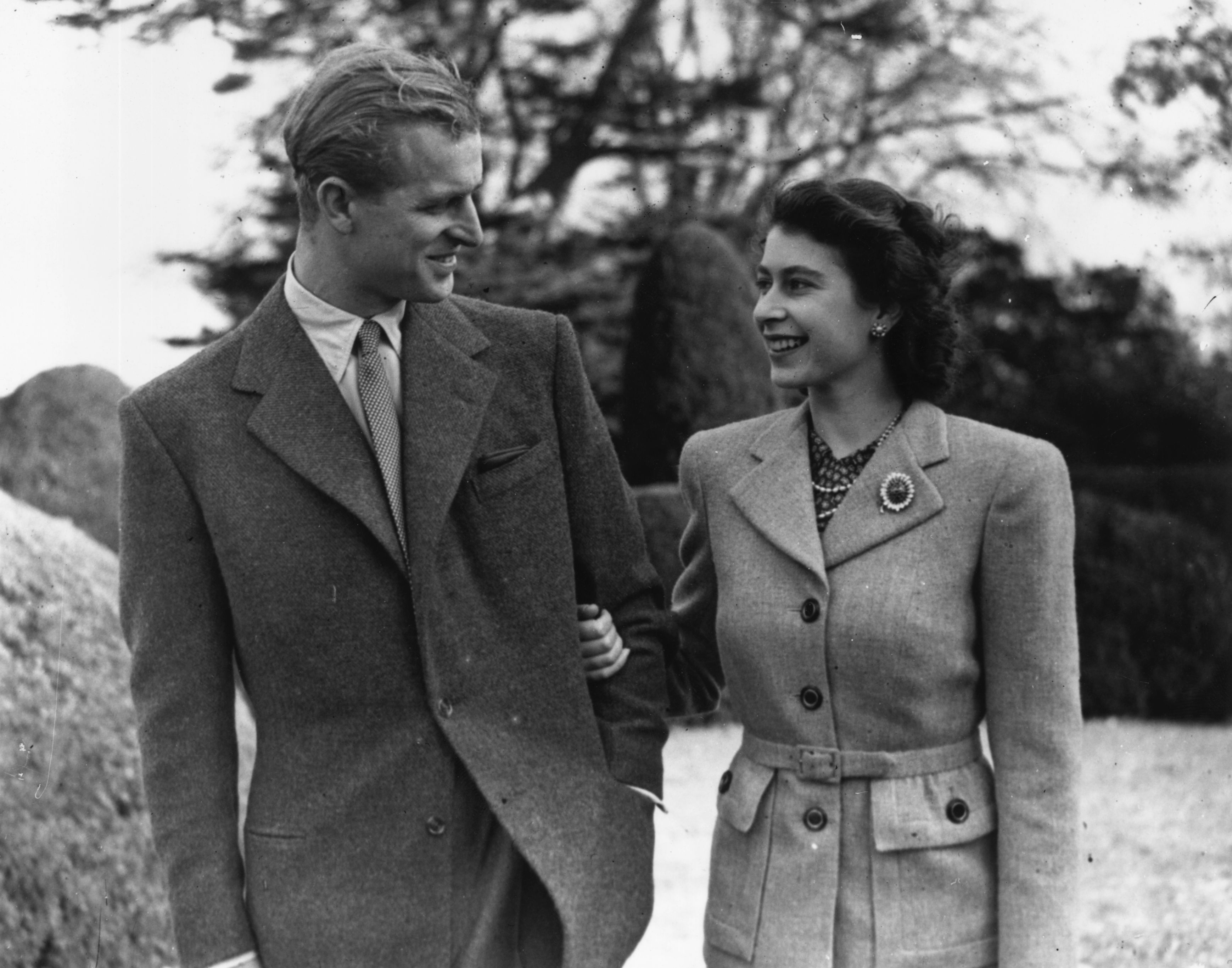 Image Source: Getty Images/Topical Press Agency/Princess Elizabeth and The Prince Philip, Duke of Edinburgh enjoying a walk during their honeymoon at Broadlands, Romsey, Hampshire
