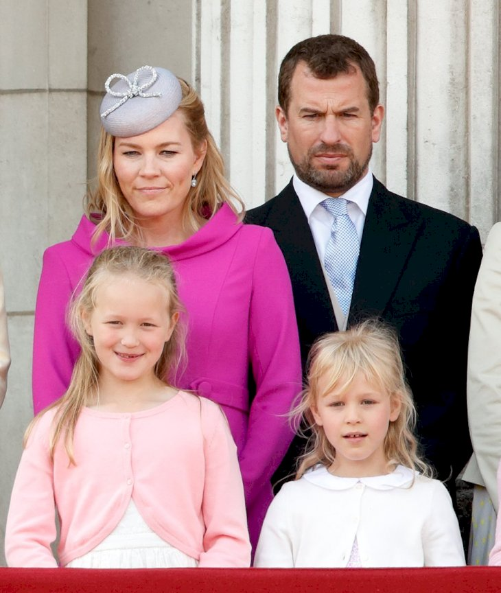 Image Credit: Getty Images / Peter Phillips with his wife, Autumn, and their daughters, Savannah and Isla.