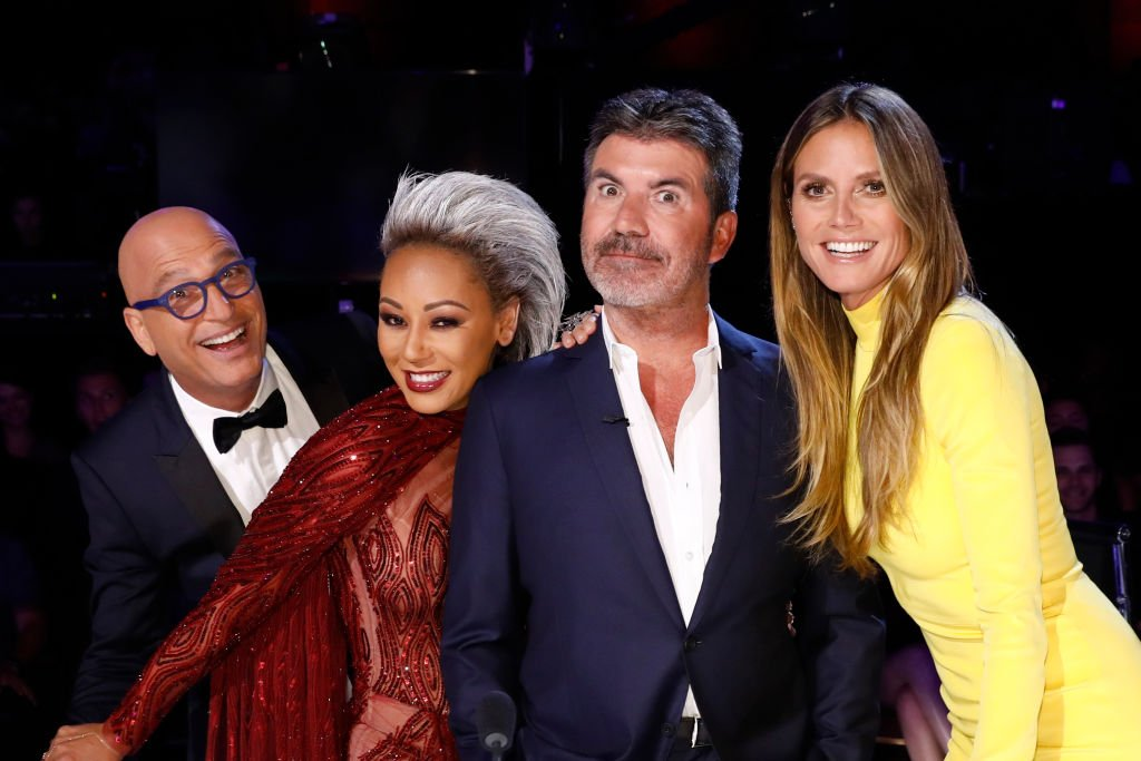 Image Credit: Getty Images / America's Got Talent, Season 12 with judges Howie Mandel, Mel B, Heidi Klum, Simon Cowell.