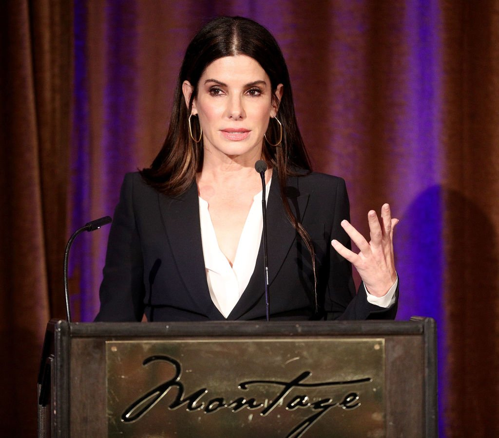 Image Credits: Getty Images / Frederick M. Brown | Actress Sandra Bullock speaks during the Beverly Hills Bar Association's 2018 Entertainment Lawyer of the Year Dinner at the Montage Beverly Hills on May 3, 2018 in Beverly Hills, California.