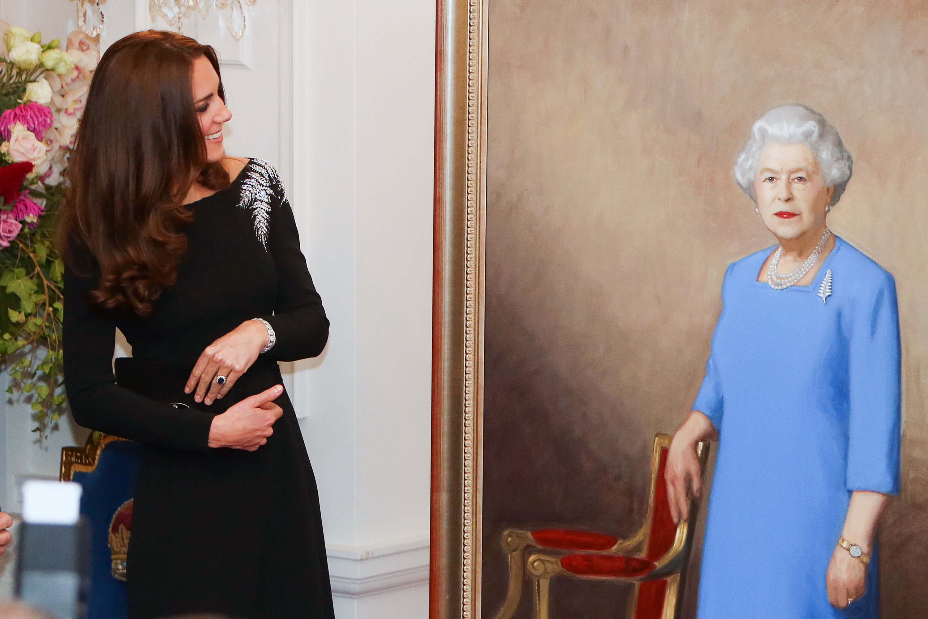Image Credit: Getty Images / Catherine, Duchess of Cambridge inspects a portrait of Queen Elizabeth II, unveiled during a state reception at Government House on April 10, 2014 in Wellington, New Zealand.