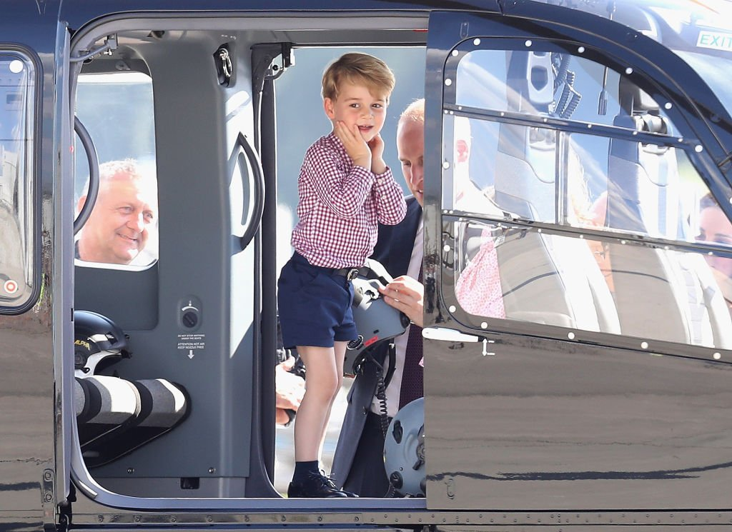 Image Credit: Getty Images / Prince George of Cambridge view helicopter models before departing on the last day of their official visit to Poland and Germany on July 21, 2017.
