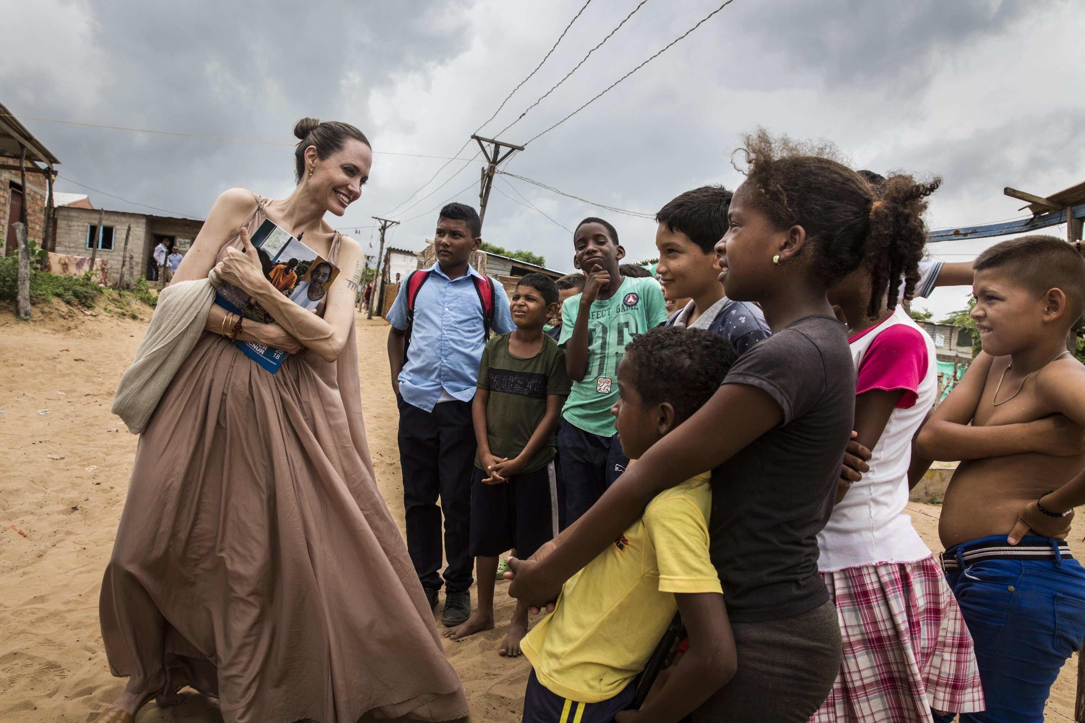 Image Source: Getty Images/Angelina in one of her mission in helping children