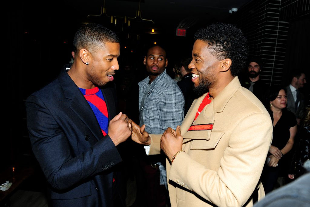 "Image Credits: Getty Images / Paul Bruinooge / Patrick McMullan | Michael B. Jordan and Chadwick Boseman attend The Cinema Society with Ravage Wines & Synchrony host the after party for Marvel Studios' ""Black Panther"" at The Skylark on February 13, 2018 in New York City."
