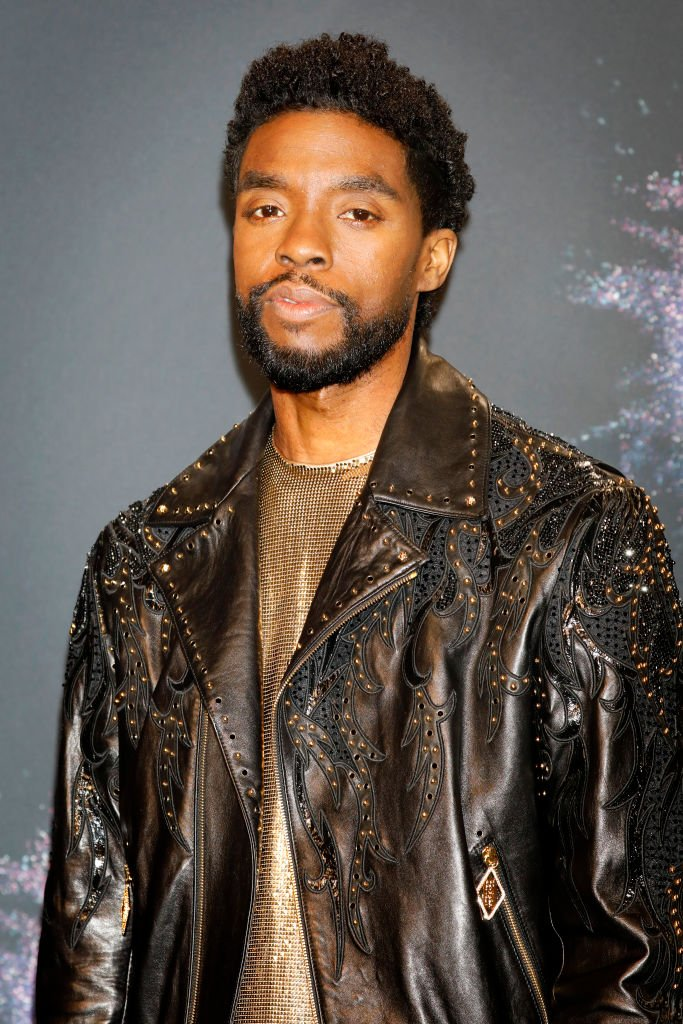 Image Credits: Getty Images / Kurt Krieger - Corbis | Chadwick Boseman arrives at the 2019 American Music Awards at the Microsoft Theater on November 24, 2019 in Los Angeles, California.