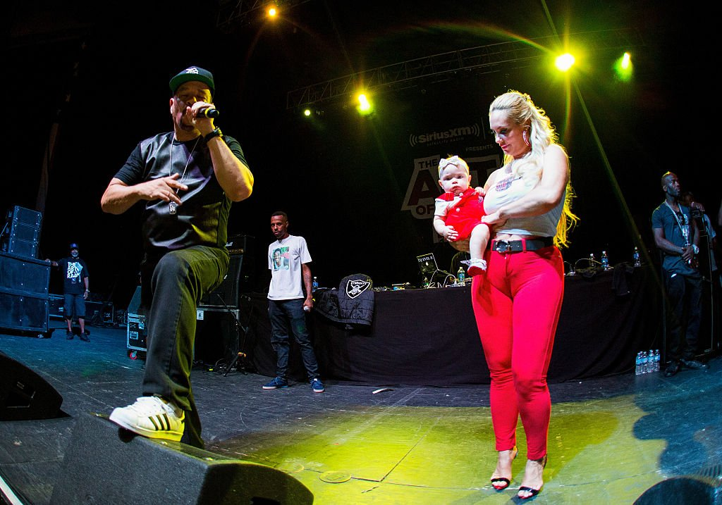 Image Credit: Getty Images / Ice T (L) with Coco Auston and daughter Chanel Nicole Marrow pose on stage during Ice T performance at Freedom Hill Amphitheater on August 6, 2016 in Sterling Heights, Michigan.