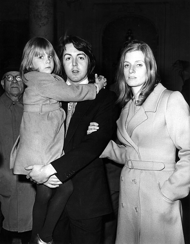 Image Credits: Getty Images / Cummings Archives / Redferns | Photo of Paul McCartney and Linda McCartney; posed with daughter Heather McCartney, on wedding day.