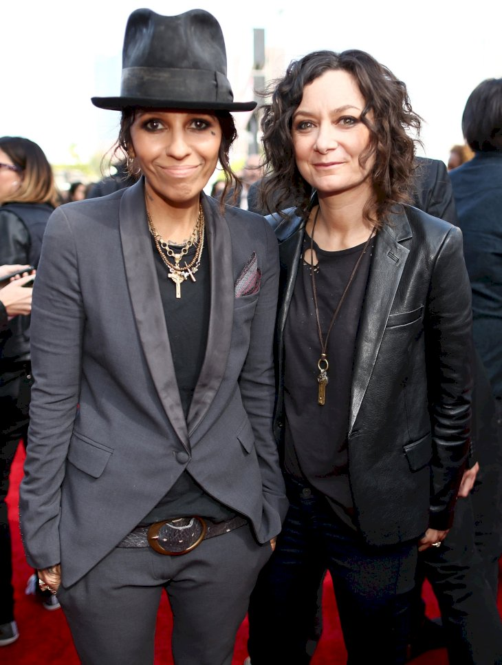 Image Credit: Getty Images/Getty Images for MTV/Christopher Polk | Linda Perry and actress Sara Gilbert attend the 2014 MTV Movie Awards