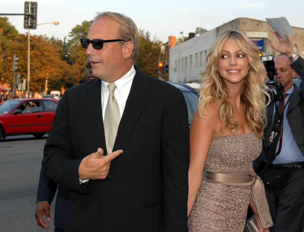 "Image Credit: Getty Images / Kevin Costner and Christine Baumgartner during ""The Guardian"" Premiere to benefit the United States Coast Guard Foundation at The Uptown Theatre in Washington, DC."