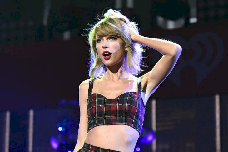 Image Credits: Getty Images / Jamie McCarthy | Taylor Swift performs onstage during iHeartRadio Jingle Ball 2014, hosted by Z100 New York and presented by Goldfish Puffs at Madison Square Garden on December 12, 2014 in New York City.