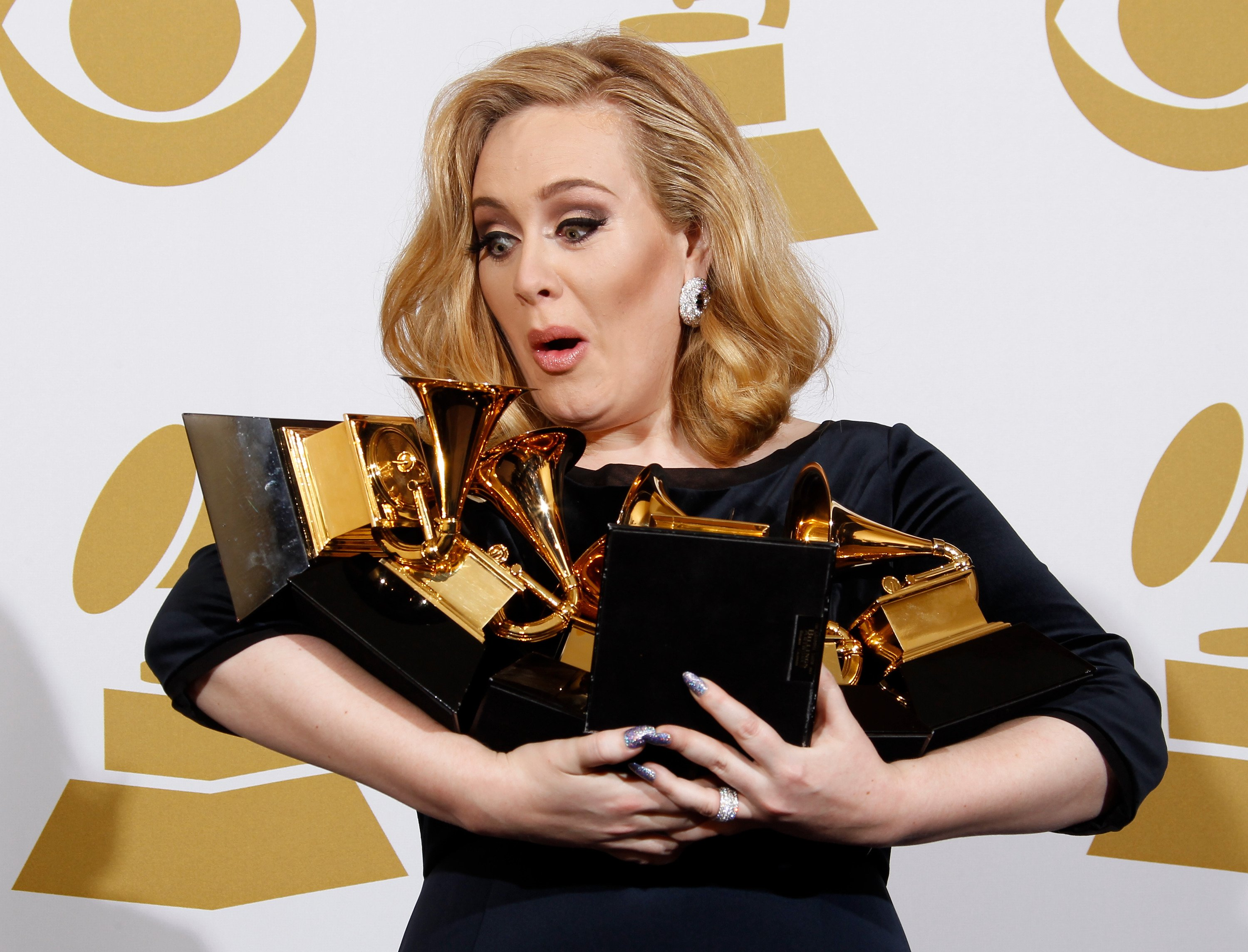 Image Credit: Getty Images / Adele flaunting her wins at the Grammy Awards.
